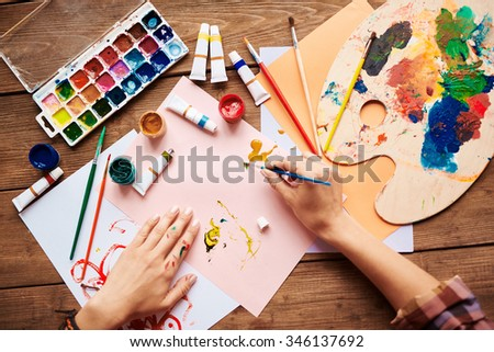 Artist painting with water colors