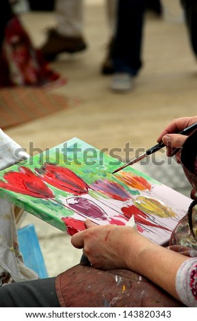 Artist paints her picture