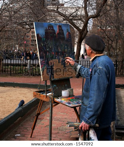 Artist paints in Washington Square of Manhattan New York
