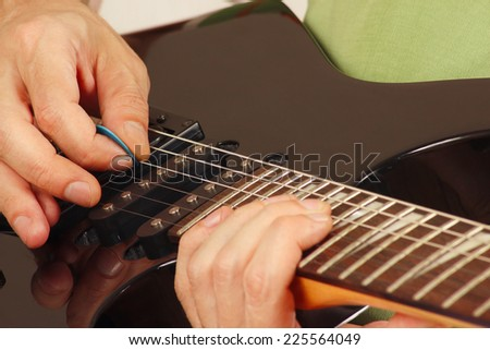 Artist Put Fingers For Chords On Electric Guitar Closeup Ez Canvas