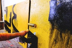 Artist's painting process . Caucasian artist working in studio. Abstra