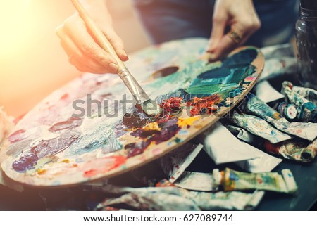 Artist's palette, close-up. Selective focus on the foreground. Background image. #627089744
