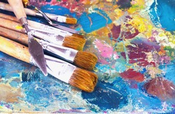 artist's palette with oil paints and brushes for painting