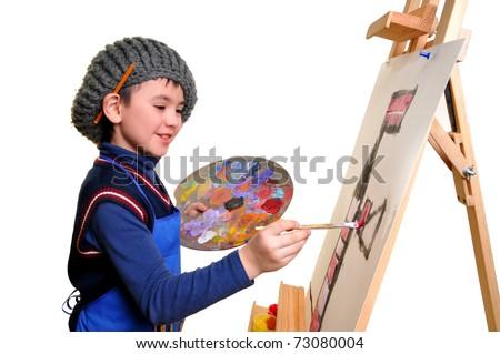 artist school boy painting brush watercolors portrait on a
