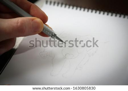 Artist sketching - pencil sketch of dog
