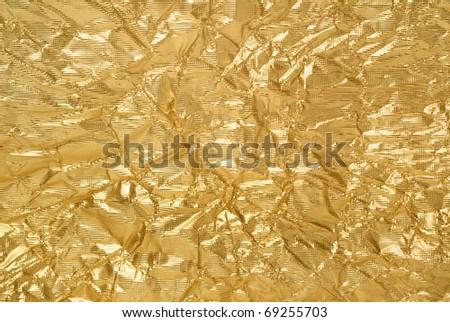 artistic background from golden foil