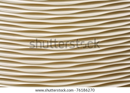 Artistic background with stripes and waves in cream color
