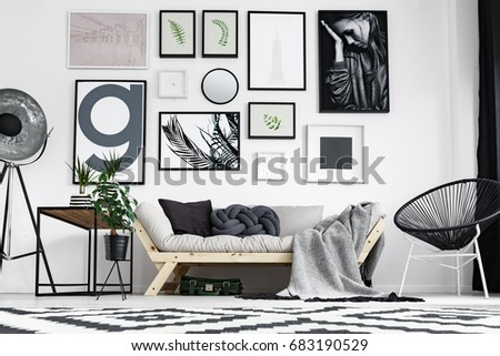 Artistic black and white living room with wooden sofa