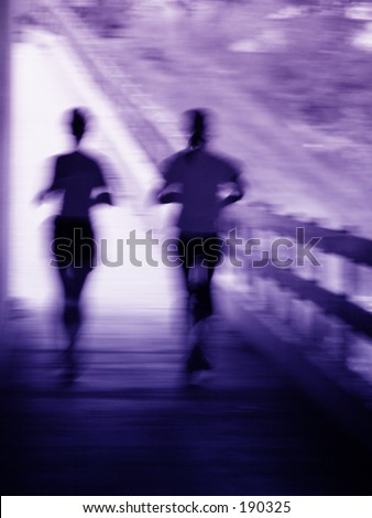 Artistic blue and purple blur of a running couple