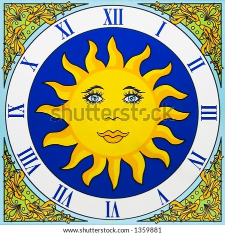 Artistic ceramic clock with a yellow sun and no pointers