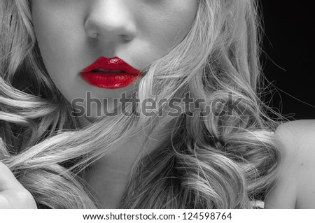 Artistic closeup photo of a young woman in studio