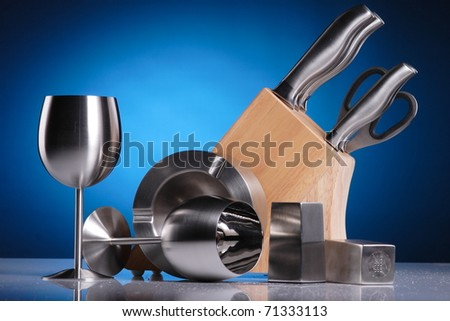 artistic composition of metal kitchen accessories