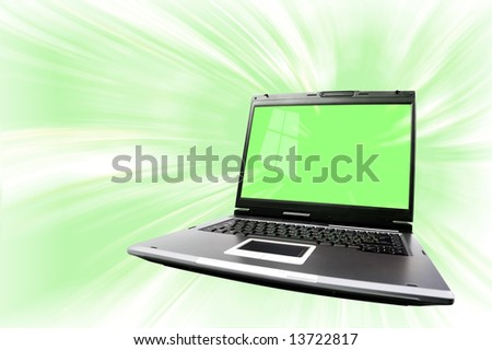 Artistic conceptual photo-illustration of a laptop computer isolated with clipping path over abstract green background