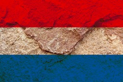 Artistic design Netherlands flag on weathered pale red rock wall background, Holland national flag texture wallpaper