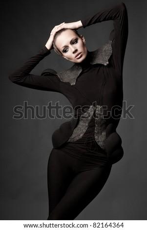Artistic girl on dark background