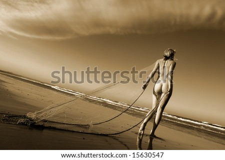 Artistic nude on beach with fishing net