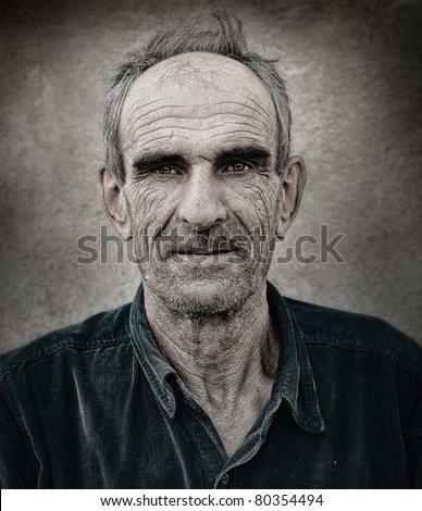 Artistic old photo of elderly bald man, grunge vintage background