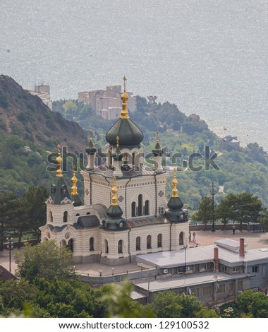 Artistic photo. Standing alone in the mountains Orthodox Church. Ukraine, Crimea, Foros.