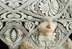 Artistic portrait of a female camouflaged in a sculpture composition