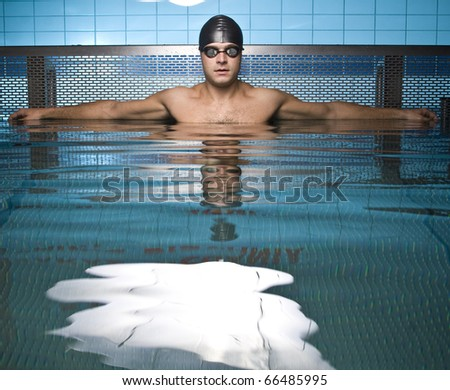 Artistic portrait of athlete swimmer in water