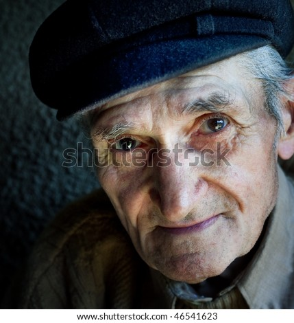 Artistic portrait of friendly senior old male