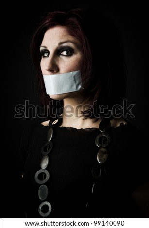 Artistic portrait of woman with tape over her mouth, signifying freedom of speech