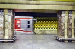 Artistic public subway train station in Prague with  train in motion blurred effect. New generation of colored and technological underground metro station without people.