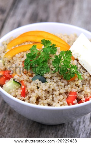 Artistic shot of quinoa salad on rustic wooden background
