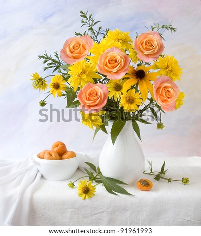 Artistic still life with cream roses and apricots
