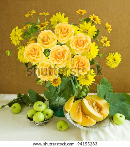 Artistic still life with huge bunch of roses and summer flowers and fruits(melon and green apples)