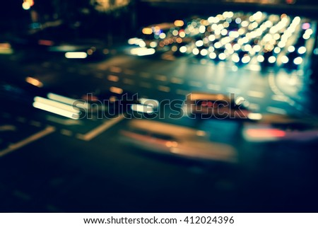 Artistic style - Vintage style, Defocused urban abstract texture bokeh city lights & traffic jams in the background with blurring lights. #412024396