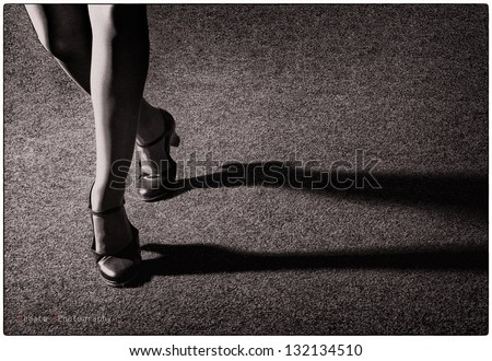 Artistic tap dancer legs dancing tap, legs fragment close up croped version, old style artistic photo in film version