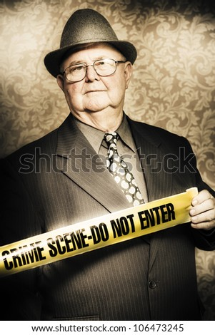 Artistically aged portrait of an astute fifties crime investigator with a stoical expression watching carefully for any clues or odd behaviour as he unwinds the yellow tape at a fresh crime scene