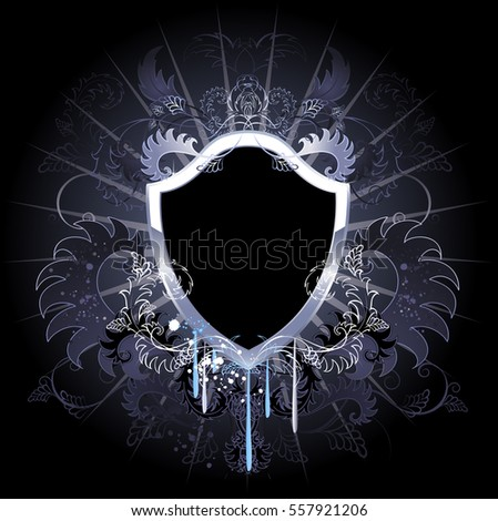 Stock Photo Artistically painted, black shield, decorated with silver and floral ornament.