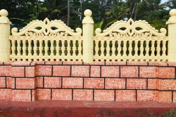 Artistically painted concrete fence/boundary wall, Kerala India.