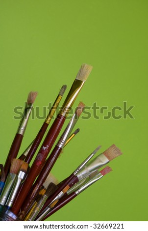 Artists brushes on green