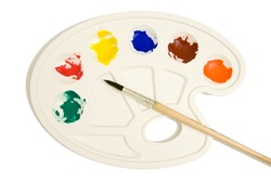 Artists palette with various colour paints and brush isolate on white background.