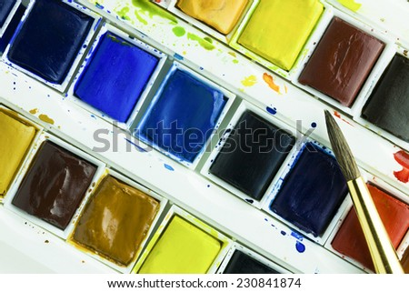 Artists watercolour paints and sable hair paint brush background hobbies and leisure time