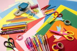 Arts and craft supplies. Corrugated color paper, pencils, different washi tapes, craft scissors.