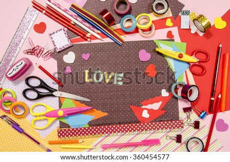 Arts and craft supplies for Saint Valentine\'s. Color paper, pencils, different washi tapes, craft scissors, hearts supplies for decoration.