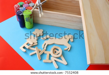 Arts and crafts paint, brushes and wooden items