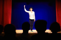 Arts and entertainment in theatre with actress on stage acting in play for audience