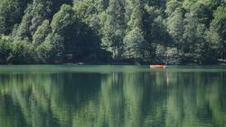 Artvin, BorckaTurkey- June 05, 2020: Unidentified people rowing in a boat in Savsat Karagol Nature Park in Blacksea region.