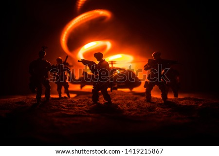 Artwork decoration. Soldiers in the desert during the military operation with combat helicopter or Helicopter assault special forces. Selective focus