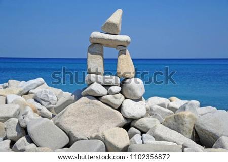 Artwork formed by stones stacked on each other - The beauty of nature in harmonious balance - Villasimius , Capo Carbonara - Sardinia ( Sardegna )  #1102356872