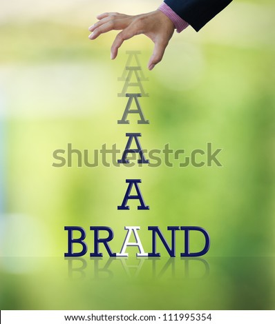Artwork of business wording with dropping letter from business hand on  abstract colorful background.