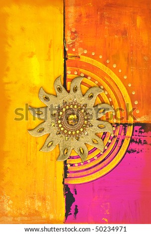 artwork with golden sun symbol