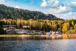 Artybash village, Lake Teletskoye, Turochaksky district, Altai Republic, Russia - September, 20, 2019: Marina with pleasure boats near the camp site
