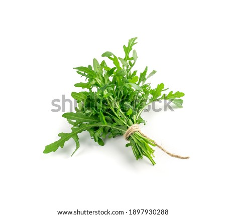 Arugula in wood bowl isolated. Fresh arugula, ruccola leaves, rucola, eruca or garden roquette salad top view ストックフォト ©