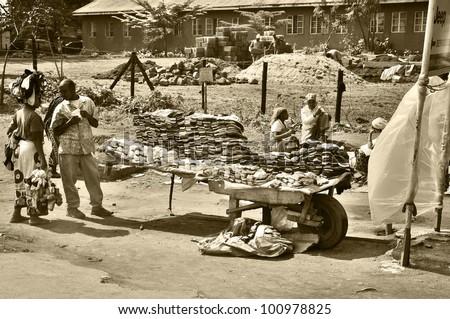 ARUSHA, TANZANIA - NOVEMBER 25: Native people made affairs near main road on November 25, 2011 in Arusha, Tanzania. Arusha is a city in northern Tanzania. It is the capital of the Arusha Region.